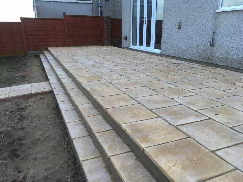 Undy ,raised patio using 450×450 buff slabs-7