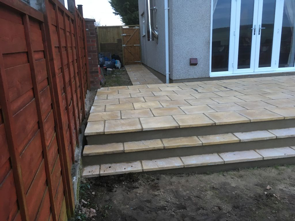Undy ,raised patio using 450×450 buff slabs-6